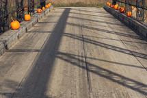 pumpkins on a bridge