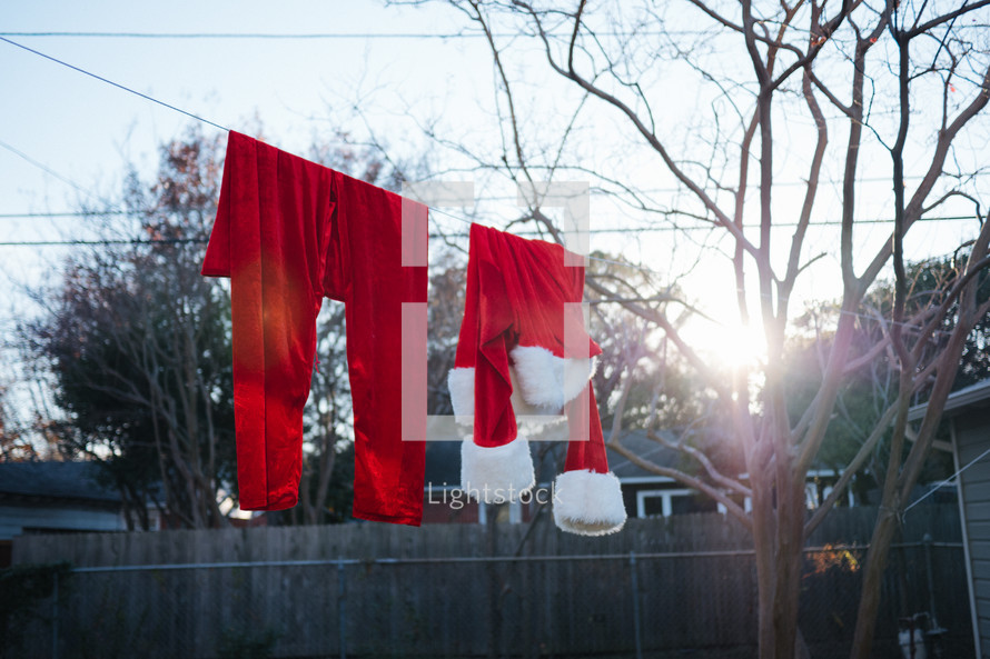 Santa suit drying on a clothesline