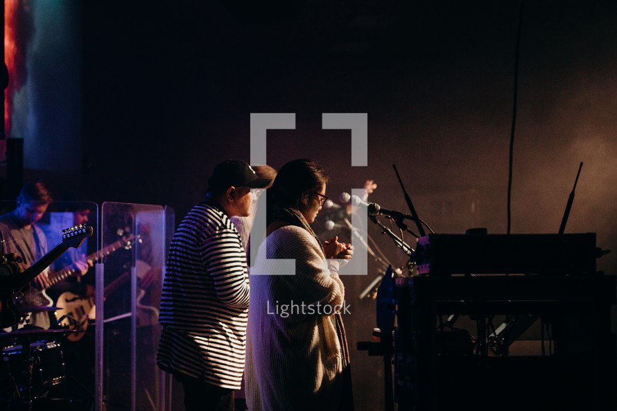 a band praying on stage