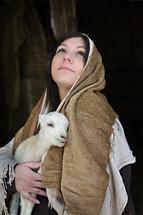 pregnant Mary holding a lamb
