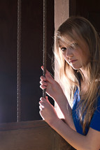 teen girl holding on to bars