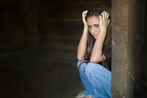 woman hiding in the corner