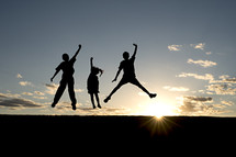 silhouette of children leaping