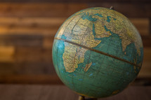 Vintage globe on a classic wood background.