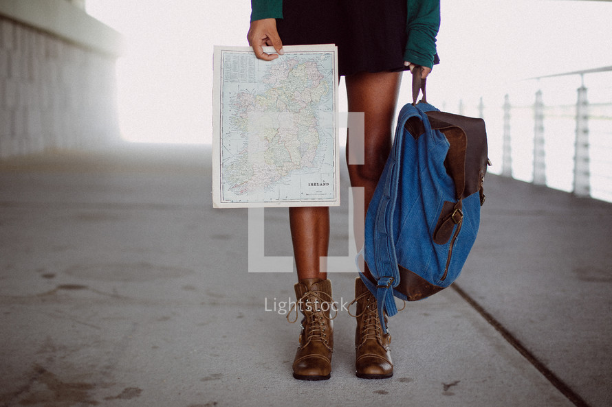 a woman with a backpack and map