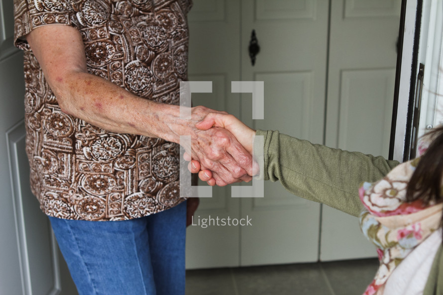 shaking hands with a neighbor