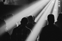 congregation standing in radiating sunlight