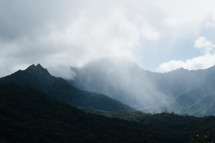 clouds over a mountaintop