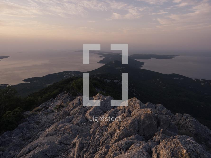 a rocky island peninsular at dawn