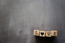 word love on wood block