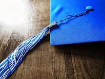 blue graduation cap and tassel