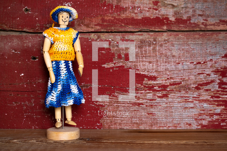 knit clothes on a figurine