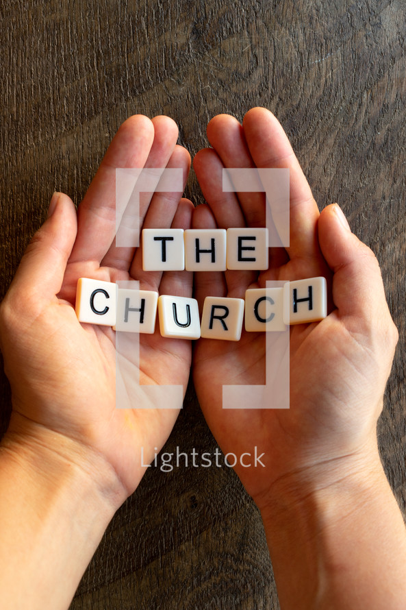 cupped hands with the words the church
