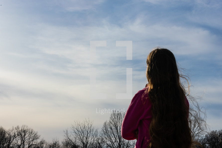 a girl looking up at the sky