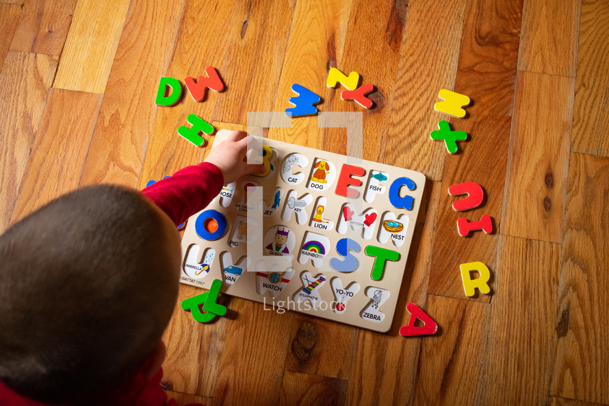 a child playing with a puzzle