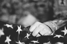 soldier gripping an American flag
