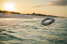 tossing a life ring into the ocean