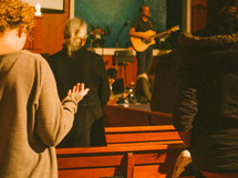 song and prayer during a worship service