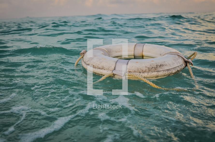 life preserver in the ocean
