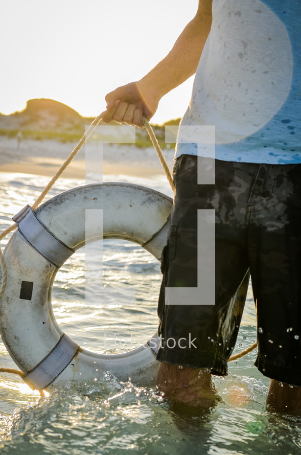 man holding a life preserver ring