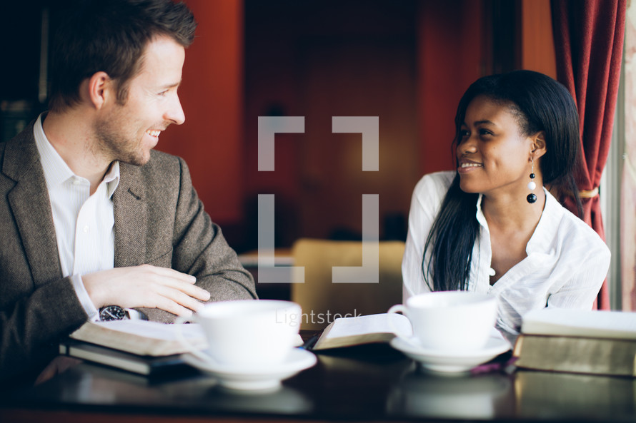 man and woman smiling at a bible study