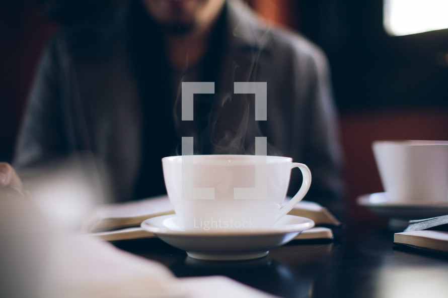 steam rising from a coffee mug