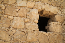 Window in stone wall Masada, Israel