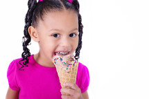 girl child eating an ice cream cone