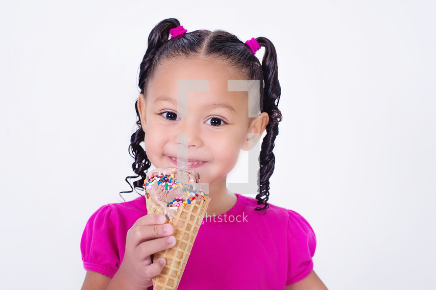 girl child holding an ice cream cone