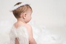 a infant in angel wings