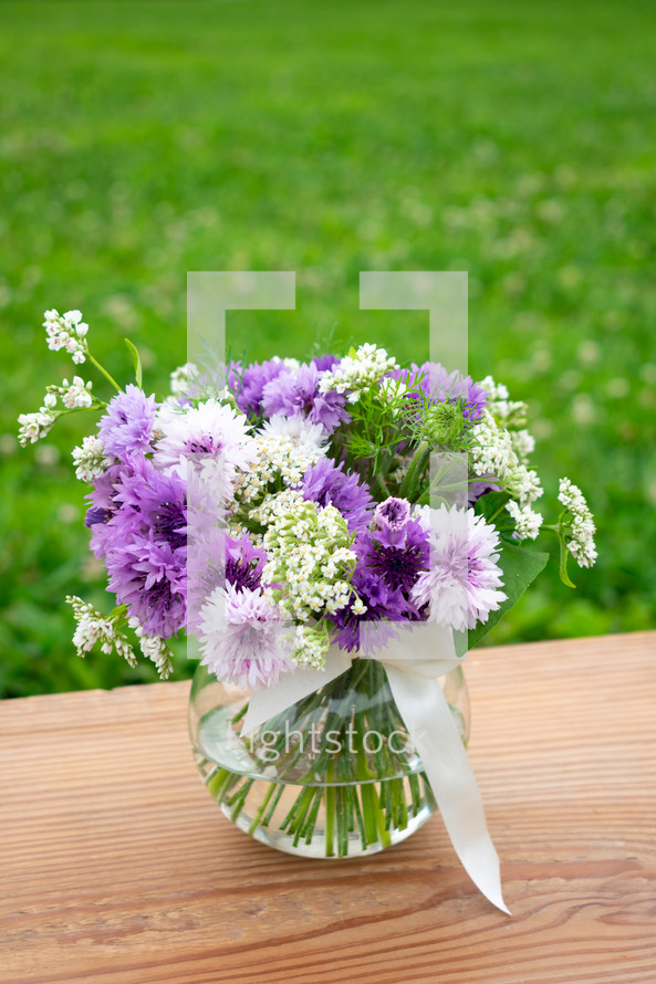 purple and white flowers in a vase