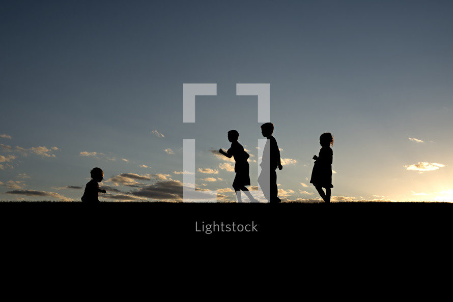 silhouettes of children playing outdoors
