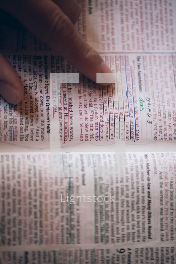 finger pointing to an underlined verse in a Bible - The Two Foundations