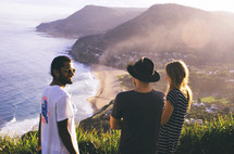 friends looking out at a view of the shoreline