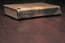Old worn bible laying on a table