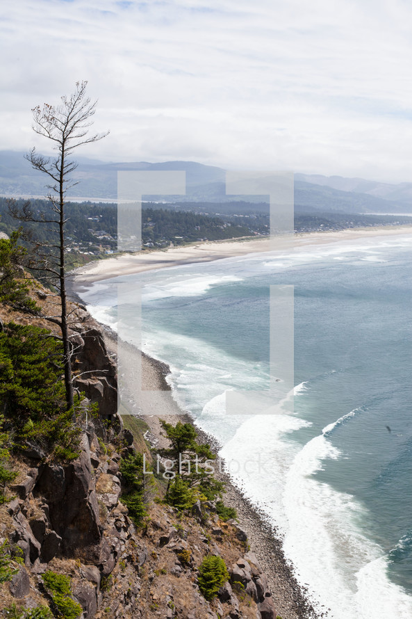 Aerial view of the ocean shoreline and waves.