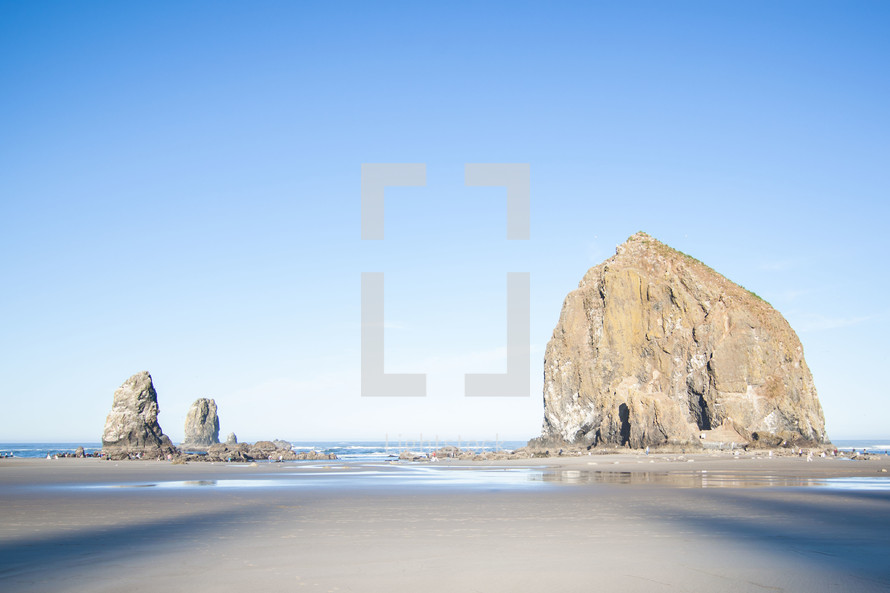 large rock formations on a beach
