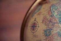 a compass on a globe