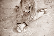 child coloring with sidewalk chalk