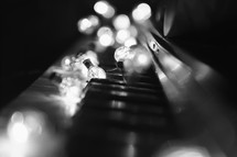 lights on acoustic piano keyboard