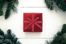 red gift box and pine garland border