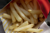 French fries in a cardboard box