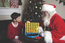 Santa and a boy playing connect four