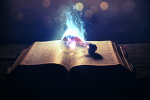 smoking lightbulb on the pages of a Bible