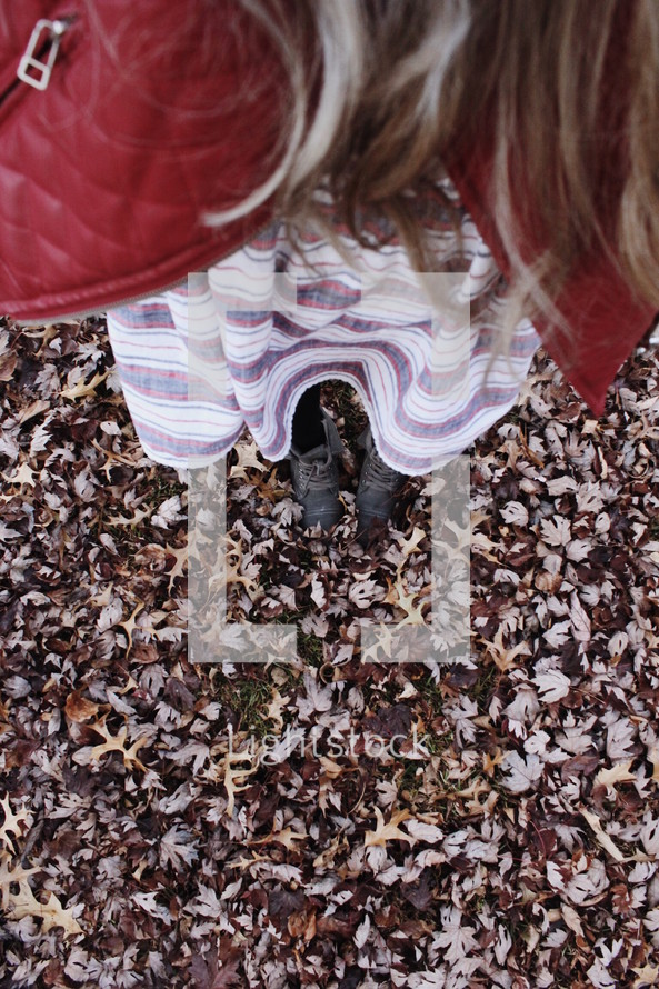 Autumn clothes in fallen leaves.