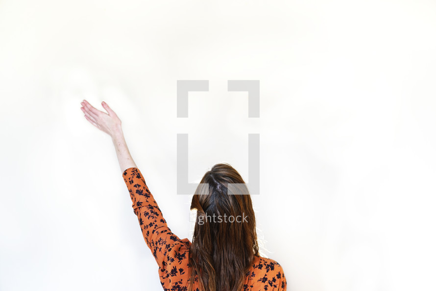 a woman with hand raised