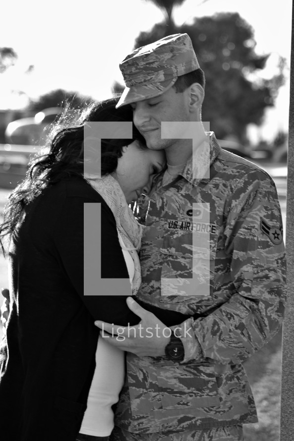 a couple hugging before a soldiers deployment