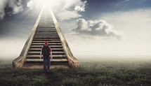 man walking up a stairway to Heaven