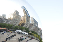 curved reflection of a city in a round object