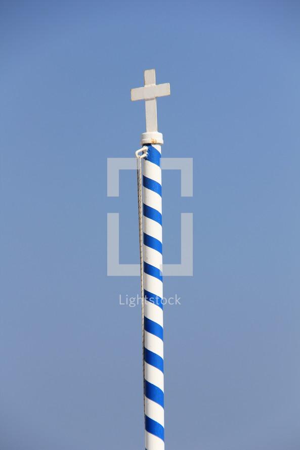 Cross on a striped pole.